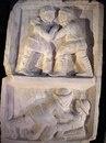 Рельеф, состоящий из двух частей, изображающий