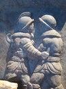 Римский рельеф, изображающий  бой гладиаторов.